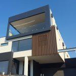 Custom built luxury home on a steep block Keilor East by Renmark