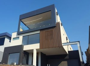 Custom built luxury home on a steep block Keilor East by Renmark