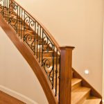 Staircase | Timber Curved Stringer | Wrought Iron Balustrades