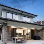 Architect designed home chocolate brick, back aspect and alfresco dining.