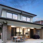 Architect designed home chocolate brick, back aspect and alfresco dining.