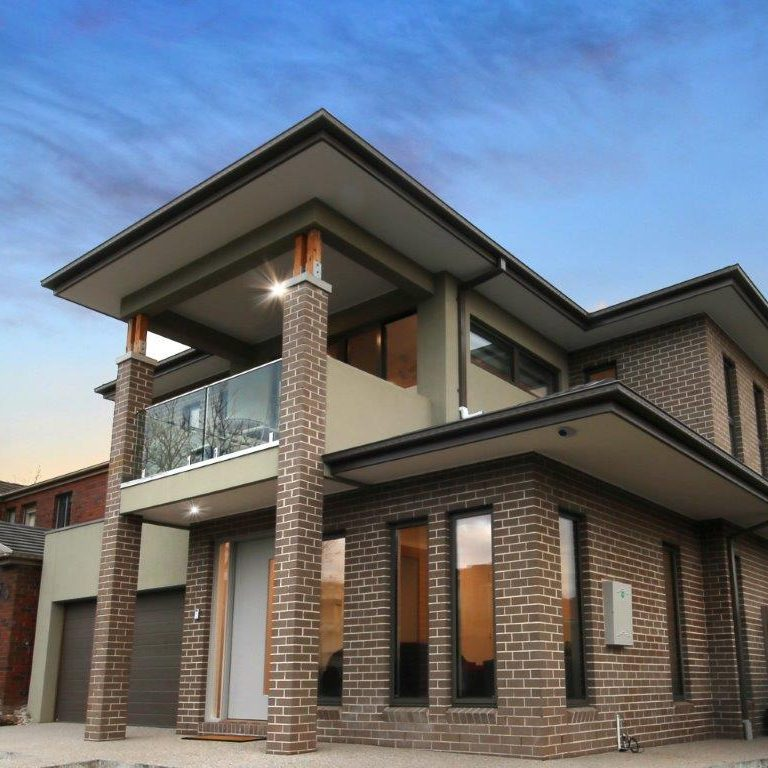 custom built double storey home. Front entrance with garage, brick and render style