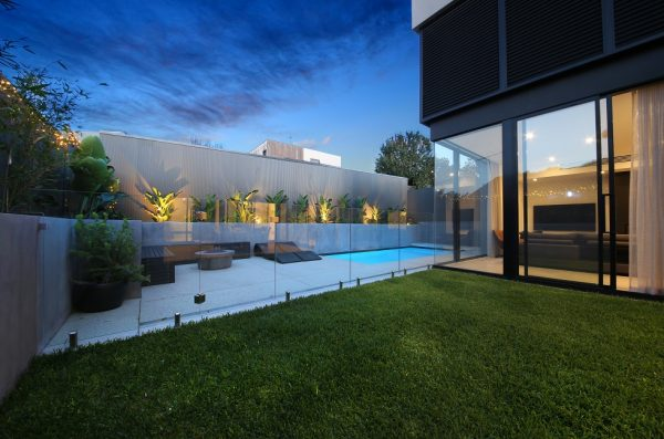 custom home backyard with pool and modern rear facade