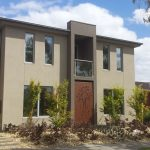 custom home design slim design windows and rusted door look