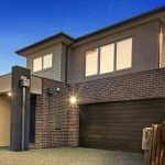 chocolate brick double storey with rendered upper storey and garage, Rectangular facade