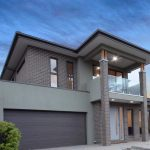 custom home built in Maribyrnong chocolate brick and rendering front entrance. Double Storey and garage on left