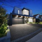 custom double storey home with charcoal facade, drive and garage