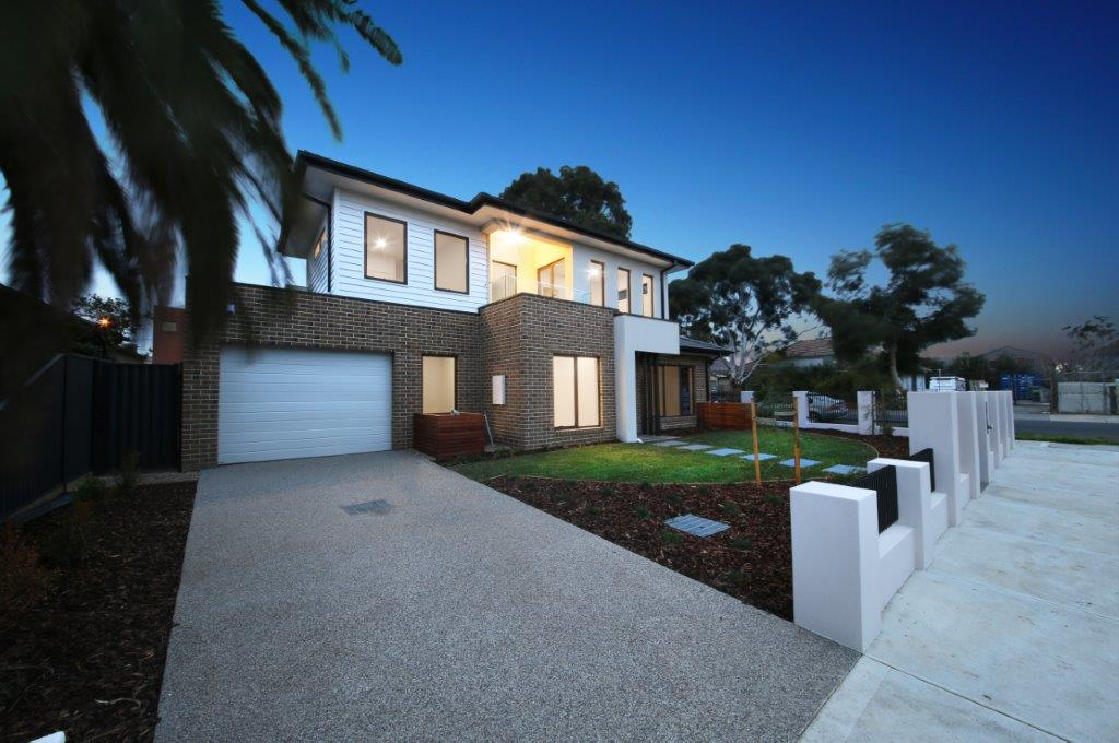 Dual Occupancy Homes on a corner block with their own front yard and driveway built by Renmark Homes