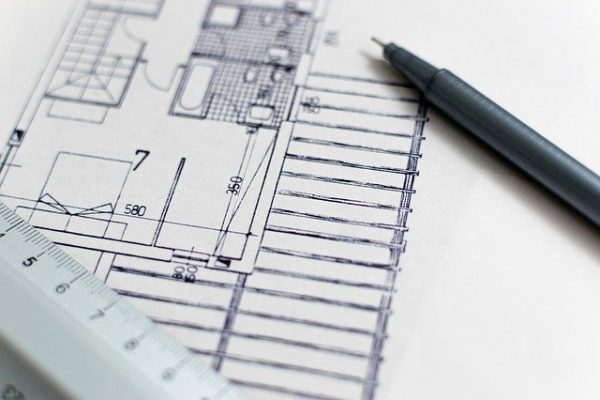 home floor plans with ruler and pen