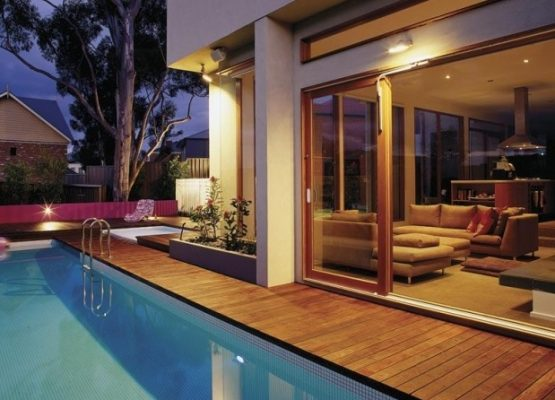 stunning new home outdoor area, wooden decking and pool